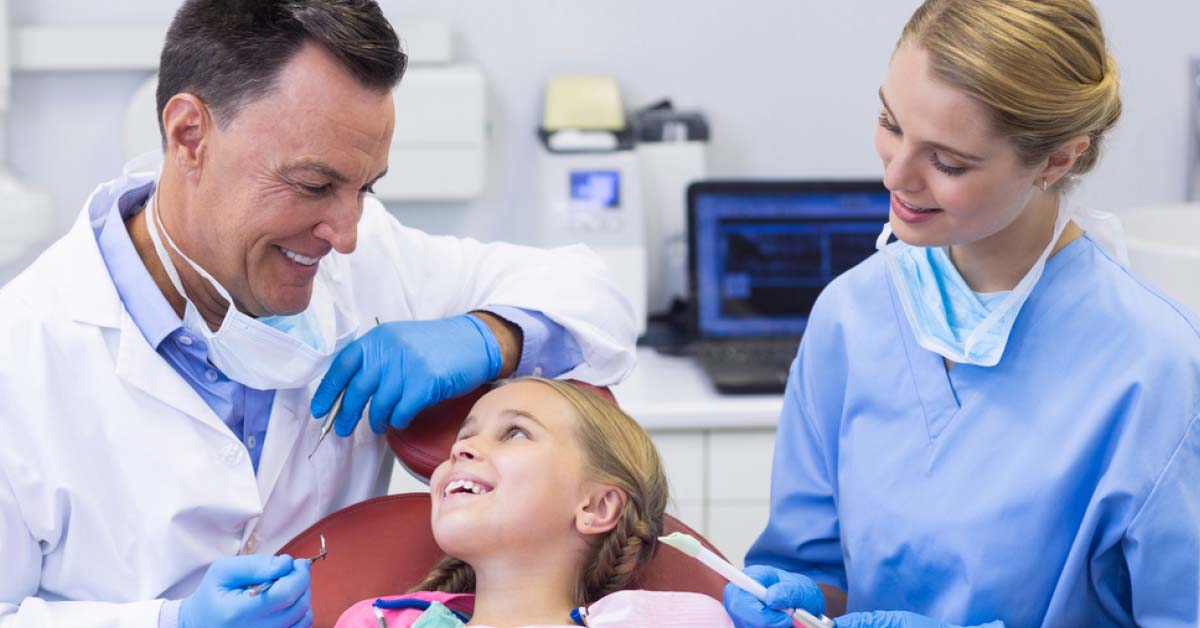 Dentist and Dental Assistant with Child - Foundation Education
