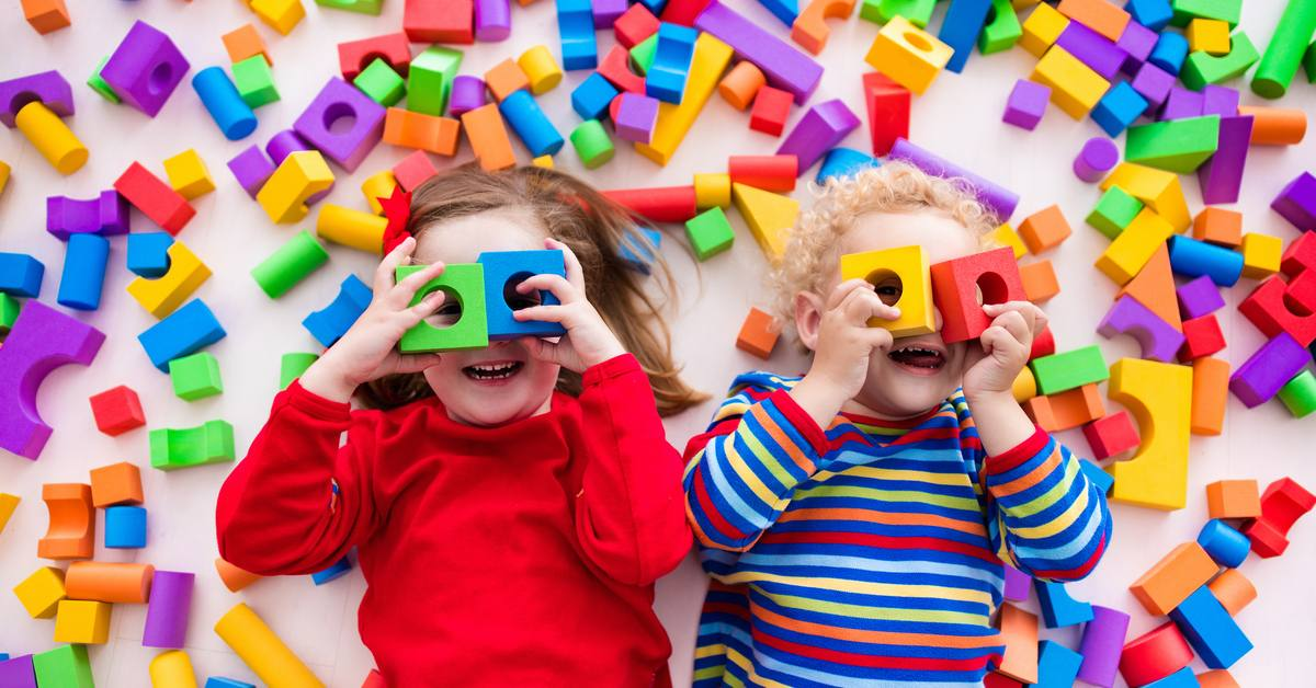 Students with ADHD playing amongst colourful blocks