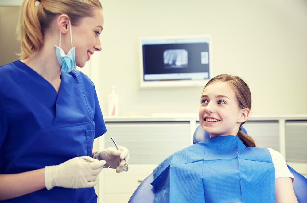Dental Hygienist Talking to Patient - Foundation Education