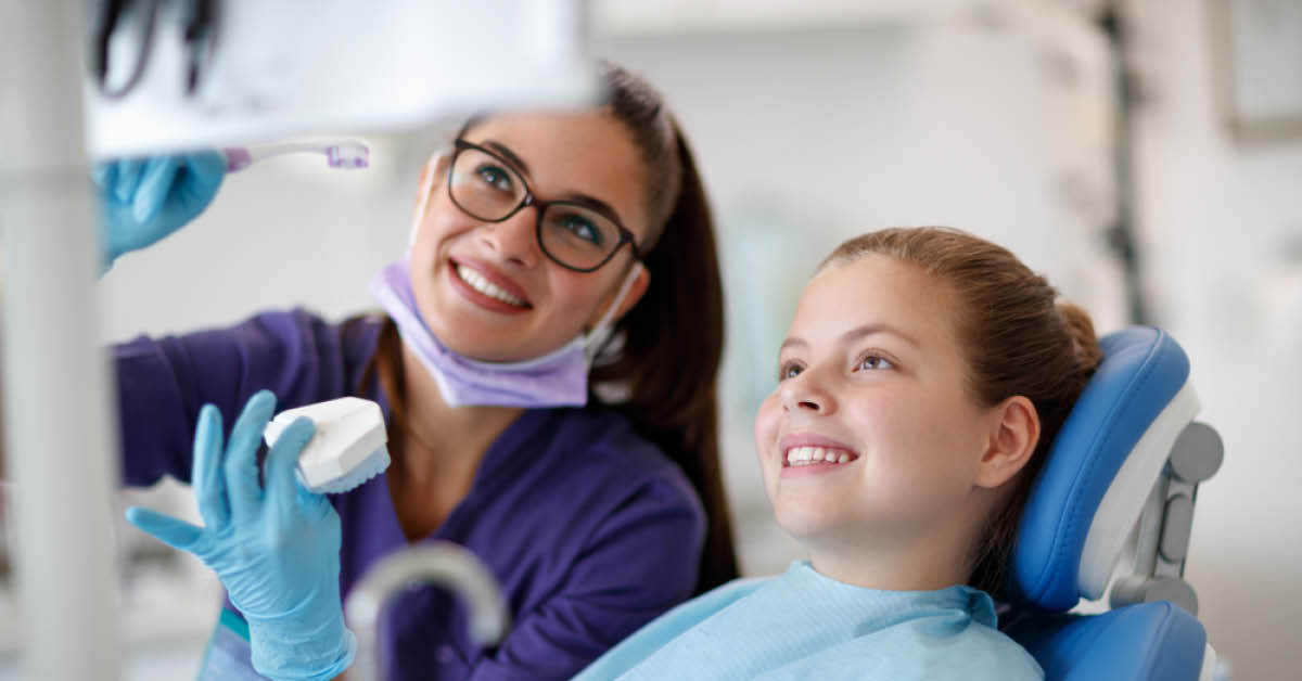Dental Hygienist with Young Patient - Foundation Education