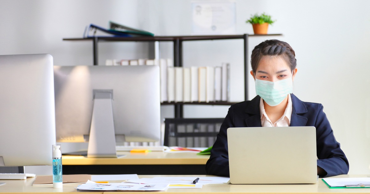 Staff member wearing a mask to pandemic proof workspace