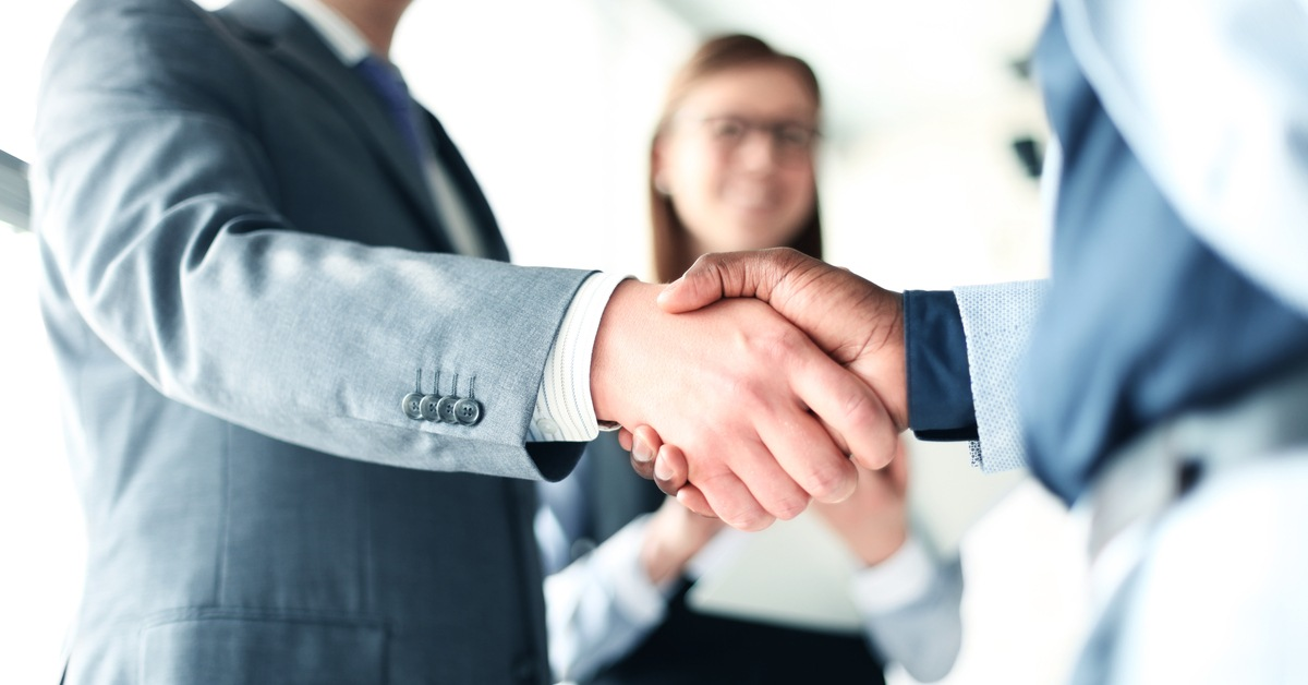 Professionals agreeing on a potential business deal