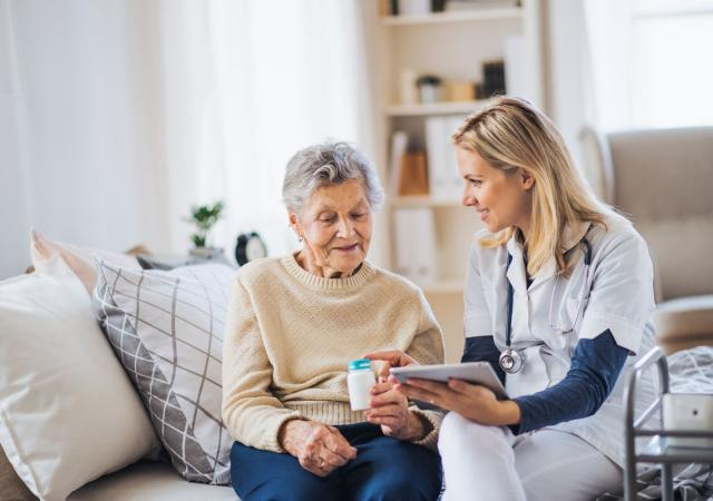 elderly woman and healthcare provider