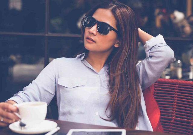 business woman enjoying a coffee outside