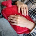 person holding hot water bottle