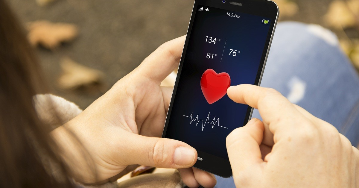 woman views heartrate on phone